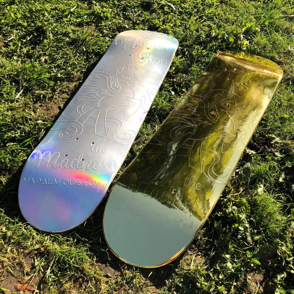 Hologram and gold graphics on skateboard - Napalm Custom